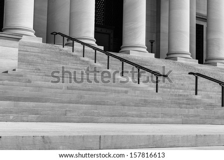 Pillars and Stairs to a Courthouse - stock photo