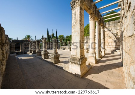 Pillars in the synagogue of Capernaum on the coast of the lake of Galilee.  According to the bible this is the place where Jesus taught - stock photo