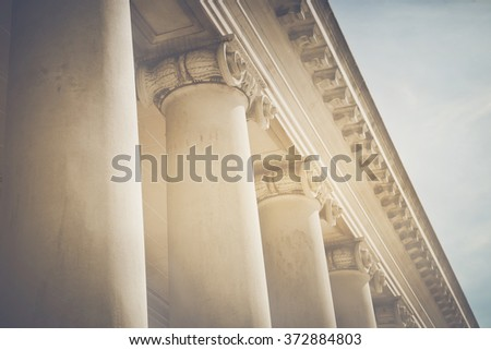 Pillars with Vintage Style Filter and Sunlight - stock photo