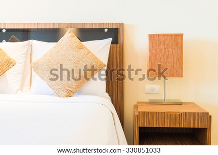 Pillow bed in luxury hotel bedroom - stock photo