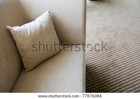 pillow lying on the sofa. - stock photo