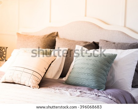 pillow on the bed with window light - stock photo