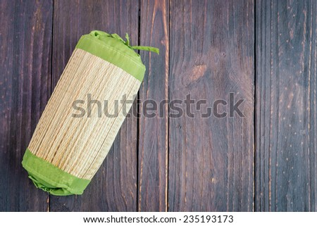 Pillow on wood background - stock photo