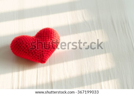pillow red heart shaped on white bed - stock photo
