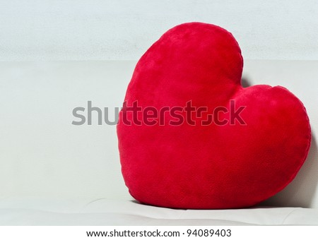 pillow red heart shaped  on white sofa - stock photo