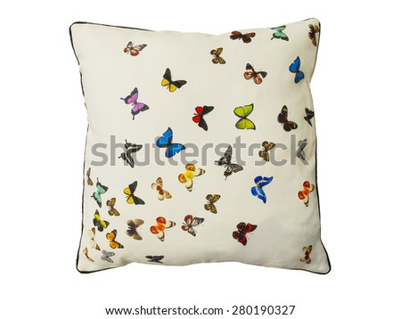 Pillow with pattern of butterflies isolated on white background - stock photo