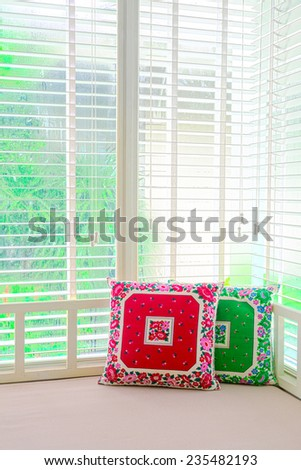 pillows on day bed  - stock photo
