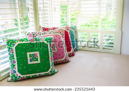 pillows on day bed with sunlight - stock photo