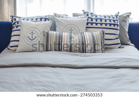 pillows on modern blue bed in bedroom at home - stock photo
