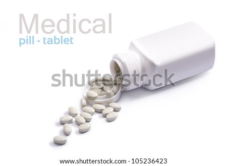 Pills and container on white background - stock photo