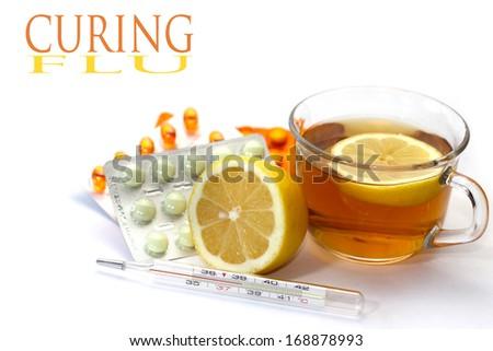 pills and hot tea  - stock photo
