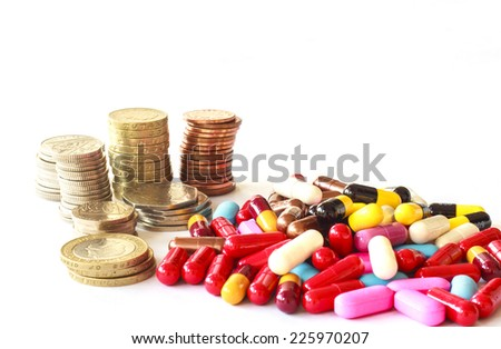 Pills and money for heal a disease budget - stock photo