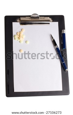 Pills and notepad - stock photo