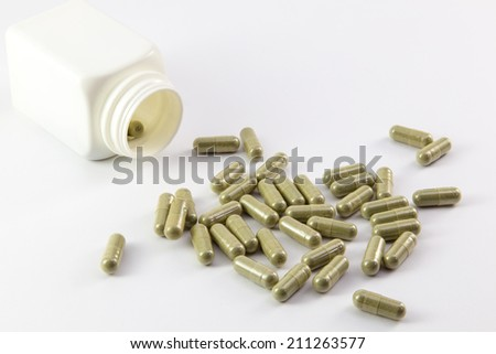 pills and pill bottle on white background - stock photo