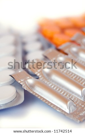 pills and suppositories on white background - stock photo