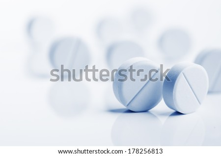 pills and tablets on a background - stock photo