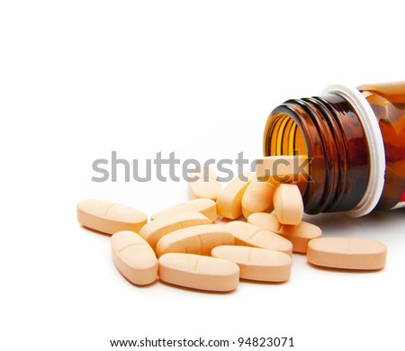 Pills from bottle on the white background - stock photo