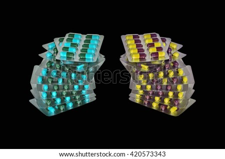 Pills in a blister pack on black background - stock photo