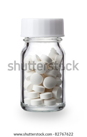 pills in a bottle isolated white background - stock photo