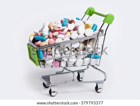 Pills in a shopping cart - stock photo