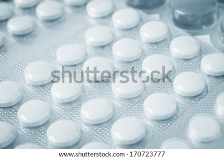 Pills in blister pack closeup - stock photo