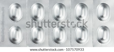Pills in blister packs as a background - stock photo