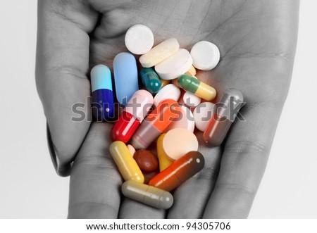 Pills in hand - stock photo