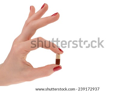 Pills in woman hand isolated on white background - stock photo