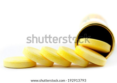 Pills of vitamin C in straw on white background - stock photo