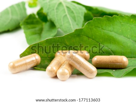Pills on green sheet - stock photo
