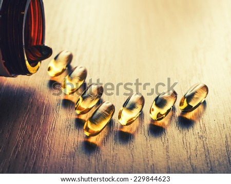 Pills out of bottle - stock photo