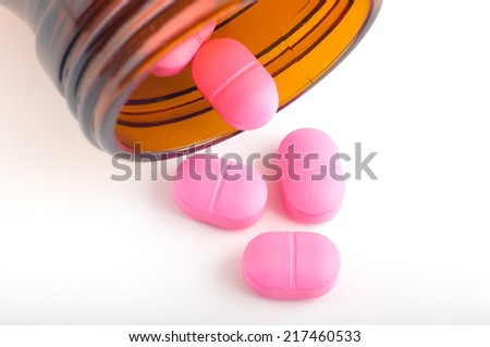 pills pouring out of the bottle - stock photo