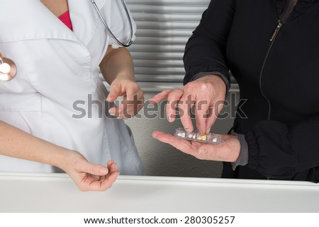 Pills, tablets and drugs heap in doctor hand, - stock photo