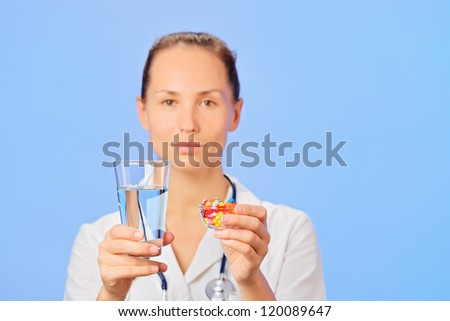 Pills, tablets and drugs heap in doctor hand, closeup view - stock photo