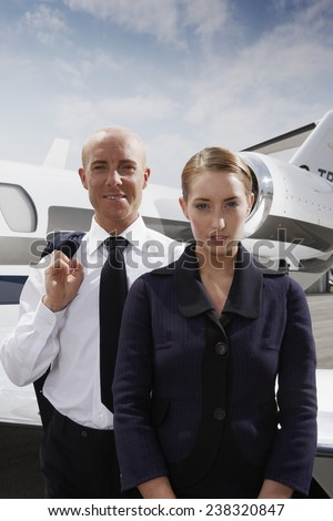 Pilot and Flight Attendant on the Tarmac - stock photo