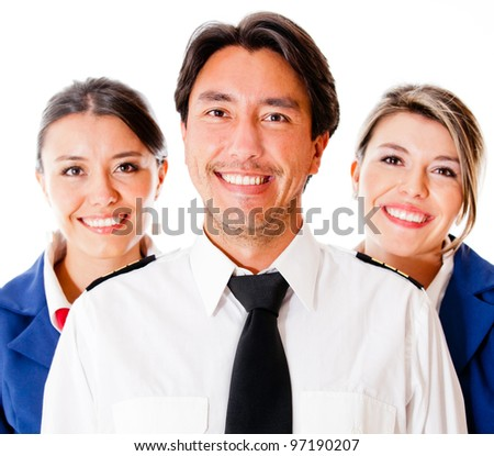 Pilot and flight attendants smiling �¢?? isolated over a white background - stock photo