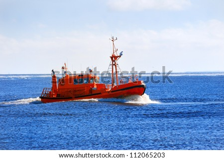 Pilot boat sailing near port of Riga - stock photo