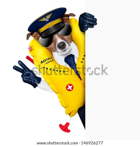 pilot captain dog wearing  emergency life vest behind a placard with peace fingers - stock photo