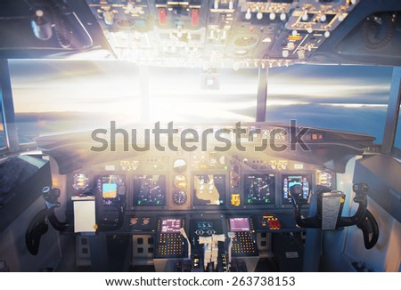 Pilot controls aircraft in the sunset lights - stock photo