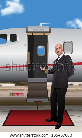 Pilot standing at the door of a private jet - stock photo