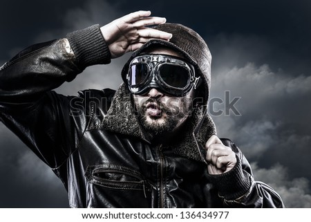 pilot with glasses and vintage hat with funny expression - stock photo