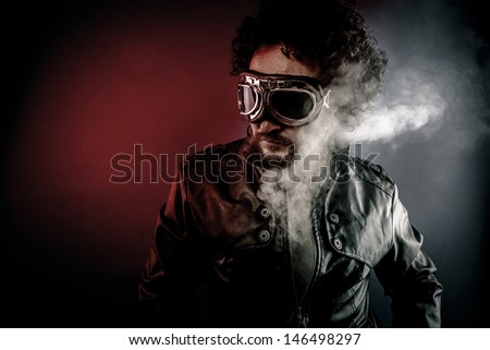 Pilot with leather jacket and smoke coming out of your body heat concept, sexy anger - stock photo