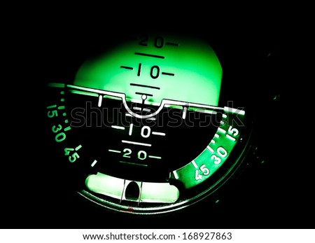 Piloting navigation in airplane - attitude direction indicator. Attitude Indicator - control panel in the cockpit military jet. - stock photo