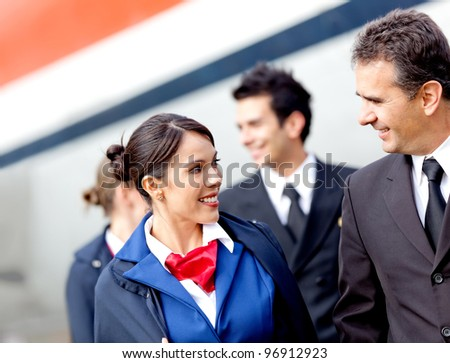 Pilots and air hostesses getting off the airplane - stock photo