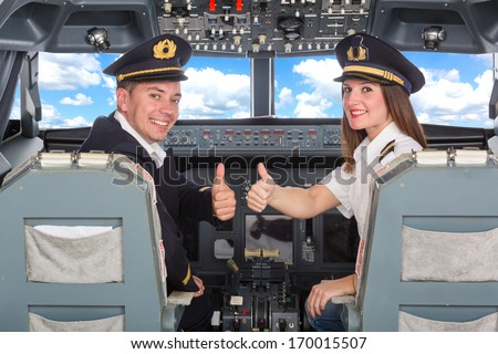 Pilots in the Cockpit - stock photo