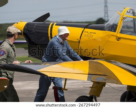 pilots pushing an aircraft at Breighton airfield,yorkshire,uk.taken 14/07/2013 - stock photo