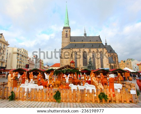 PILSEN CZECH REPUBLIC - DECEMBER 8, 2014: Artistic wooden Bethlehem Holy family on the Christmas market in the city center. It is Czech's traditional handicraft with a very long history.  - stock photo