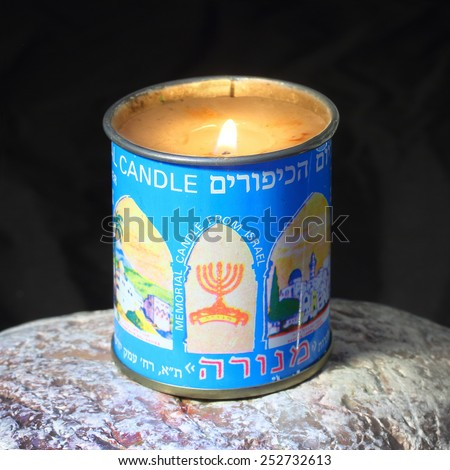 PILSEN CZECH REPUBLIC - FEBRUARY 13, 2015: Burning kosher candle for Yahrzeit and Yom Kippur (Memorial Candle) for Jewish Memorial. - stock photo