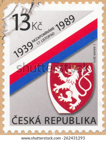 PILSEN, CZECH REPUBLIC - MARCH 21, 2015: A stamp printed in Czech republic shows national coat of arms and tricolor to anniversary of International Students Day, which is held annually on November 17. - stock photo