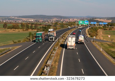 PILSEN, CZECH REPUBLIC - OCTOBER 1, 2015: Trucks on the D5 highway. The D5 is important transport connection between West Bohemia and Bavaria in Germany. - stock photo